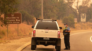Police talk to residents hoping to return to their properties at a road block on Great Northern Highway in Perth, Tuesday, February 2, 2021. An out-of-control bushfire burning near the Perth Hills has engulfed at least three homes and is threatening more…