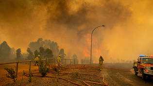 A supplied image obtained on Wednesday, February 3, 2021, of Fire fighters in Western Australia battling a blaze at Wooroloo, near Perth, Tuesday, February 02, 2021. More than 70 homes have been destroyed by a bushfire that's been burning out of control…